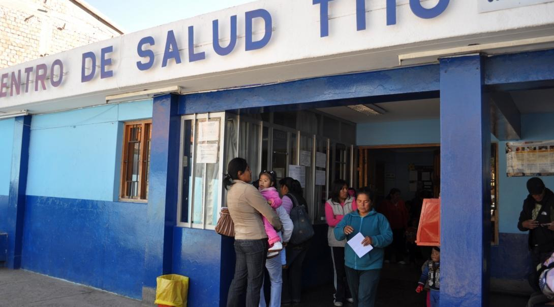 Locals are seen queueing outside a local surgery waiting to see Projects abroad interns on theri medical internship in Peru.